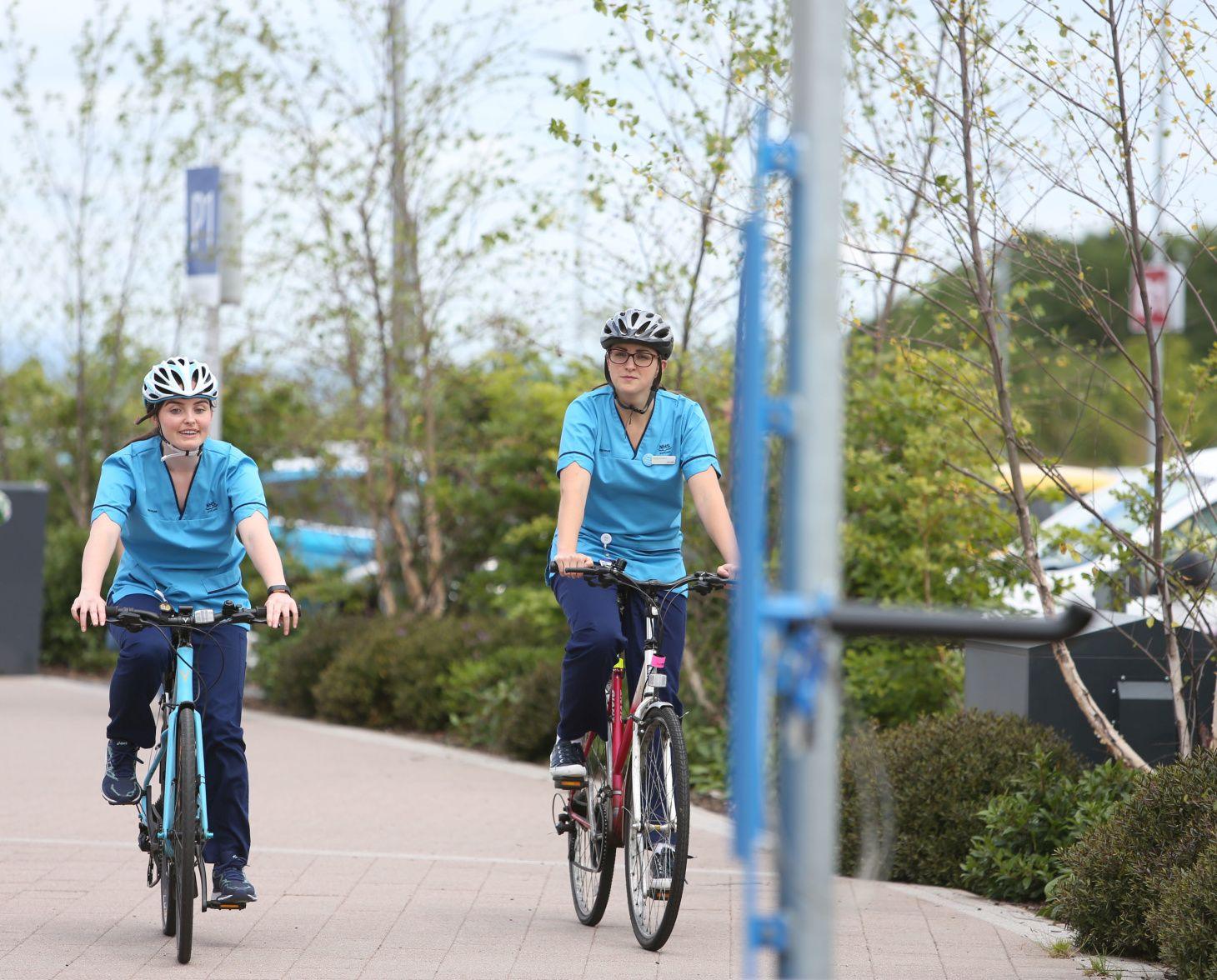 2 hospital staff members riding bikes