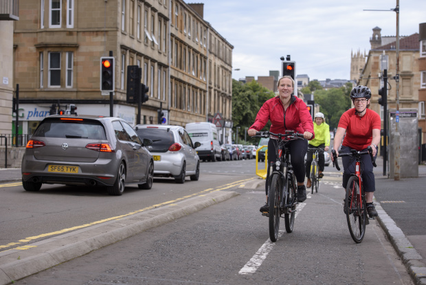 Commuters cycle on a segregated bi-directional cycle path to get to work