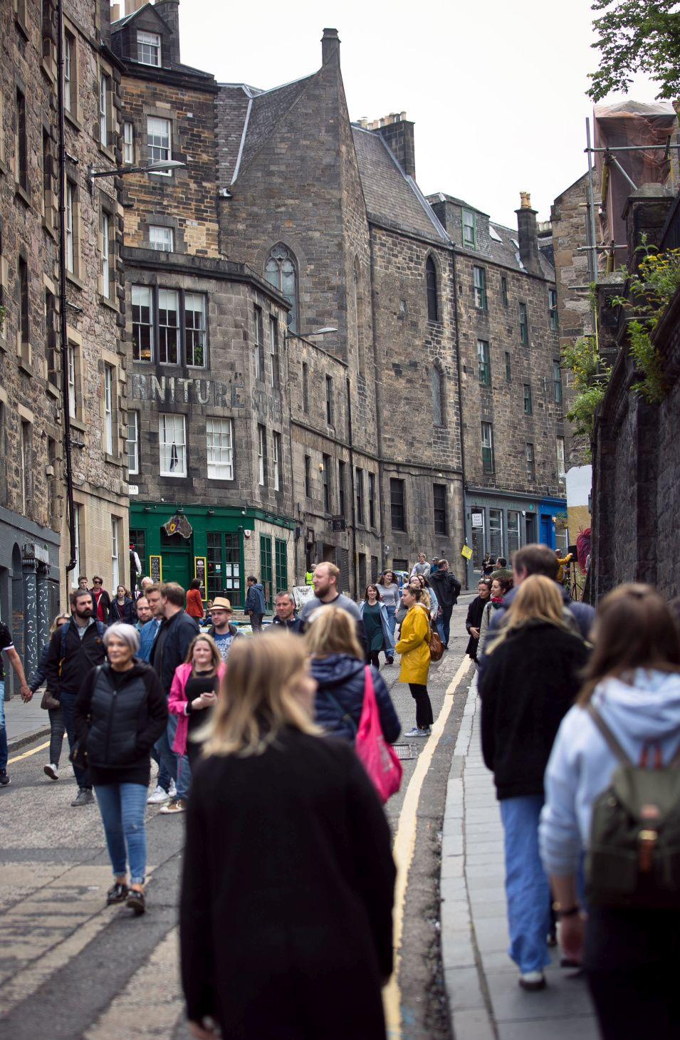 People walking in the road in Edinburgh