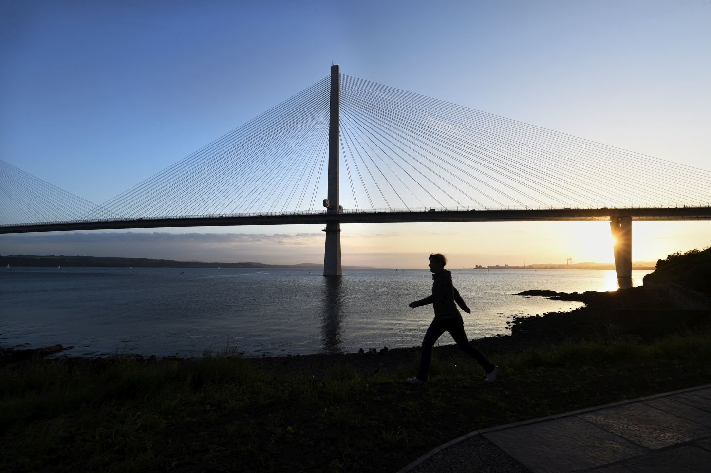 Person walking past the Queensferry crossing