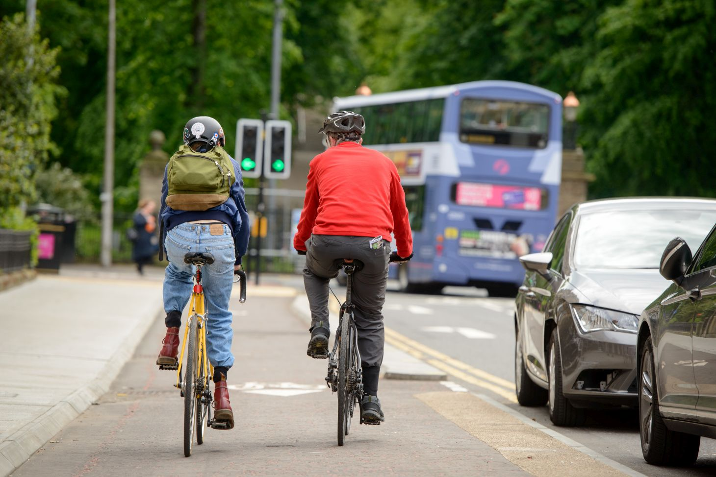 2 cyclists riding in cycle lane